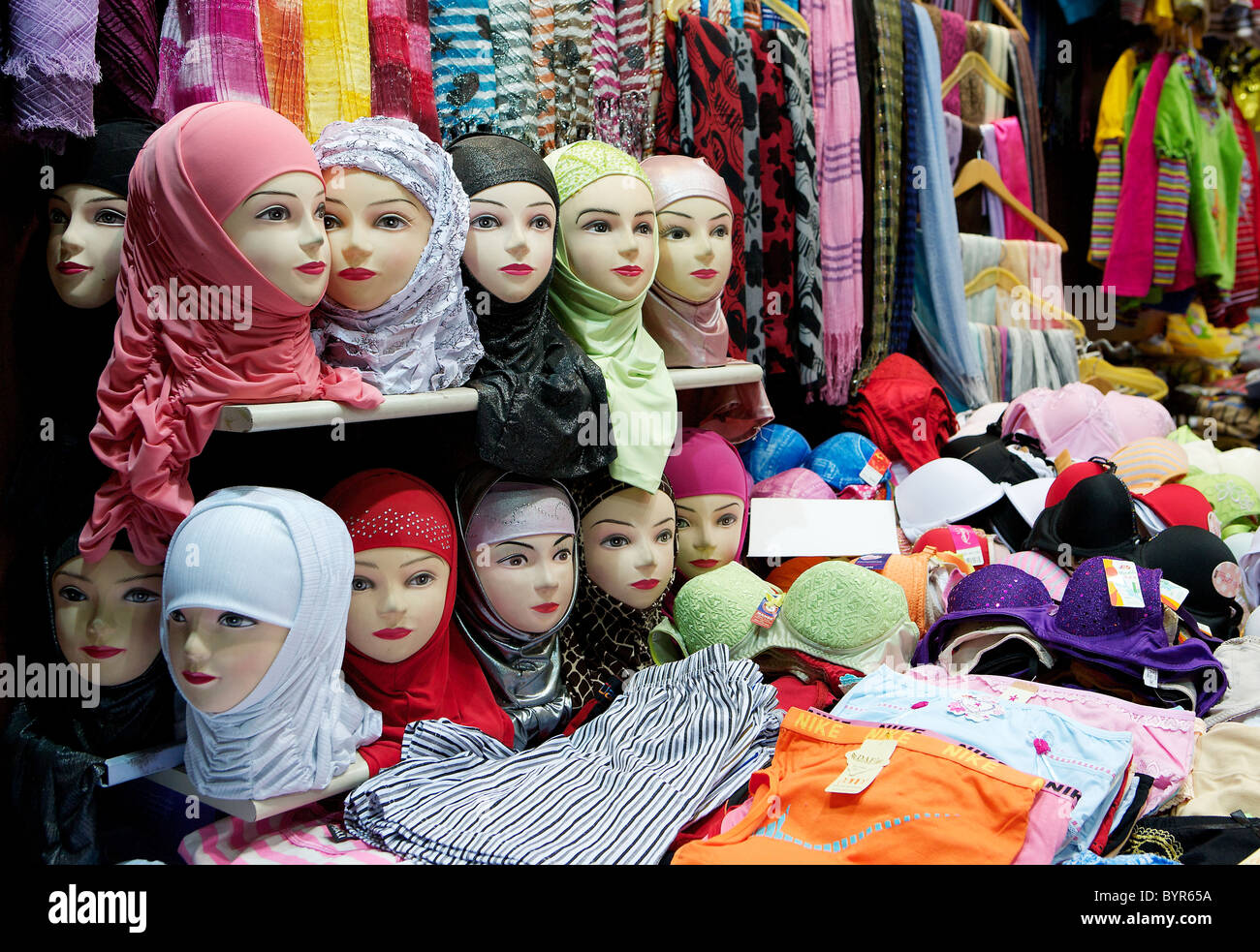 Traditional headscarves for sale in Damascus souk, Syria - Stock Image
