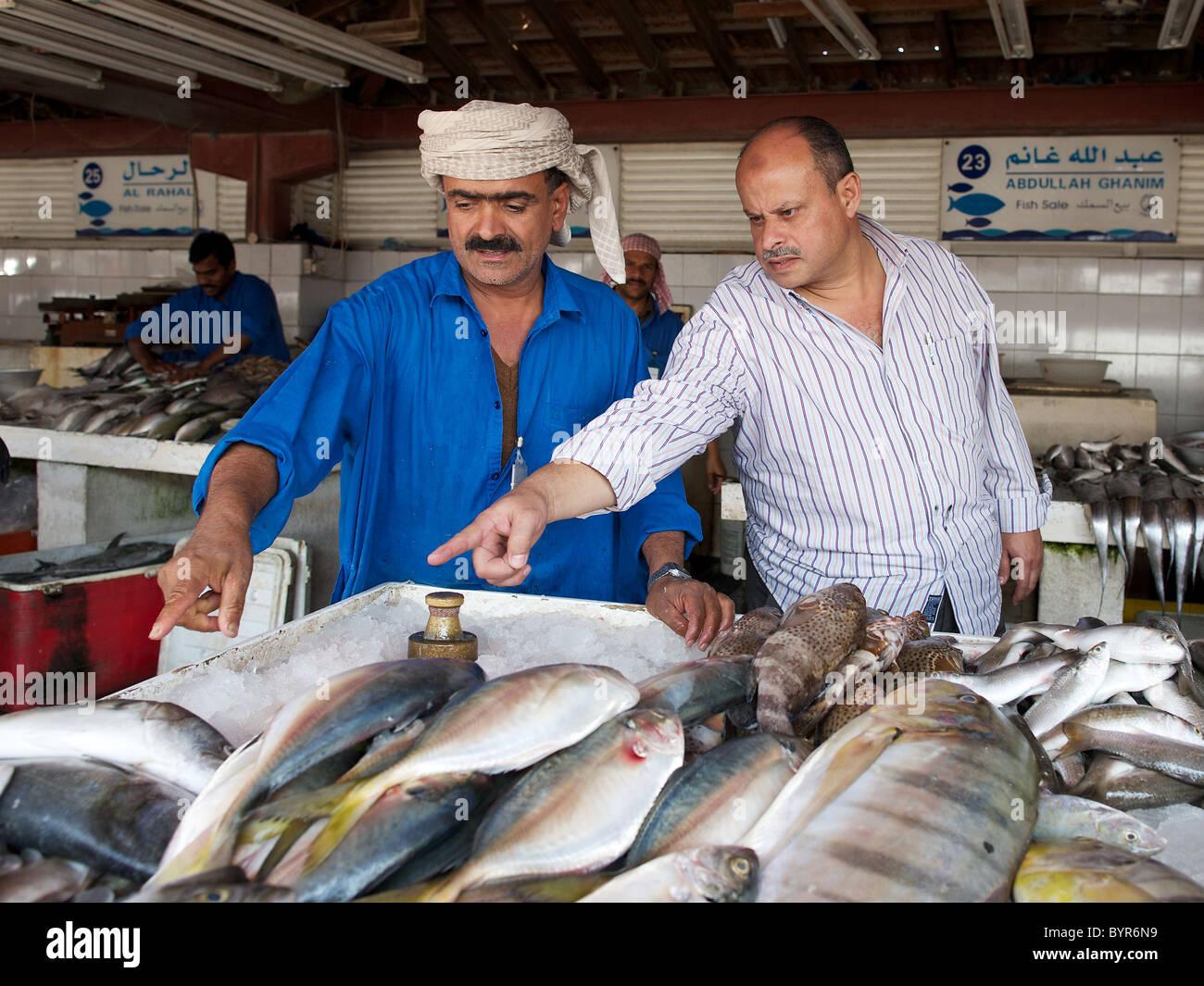 Choosing fresh fish at Sharjah fish market, Dubai, UAE Stock