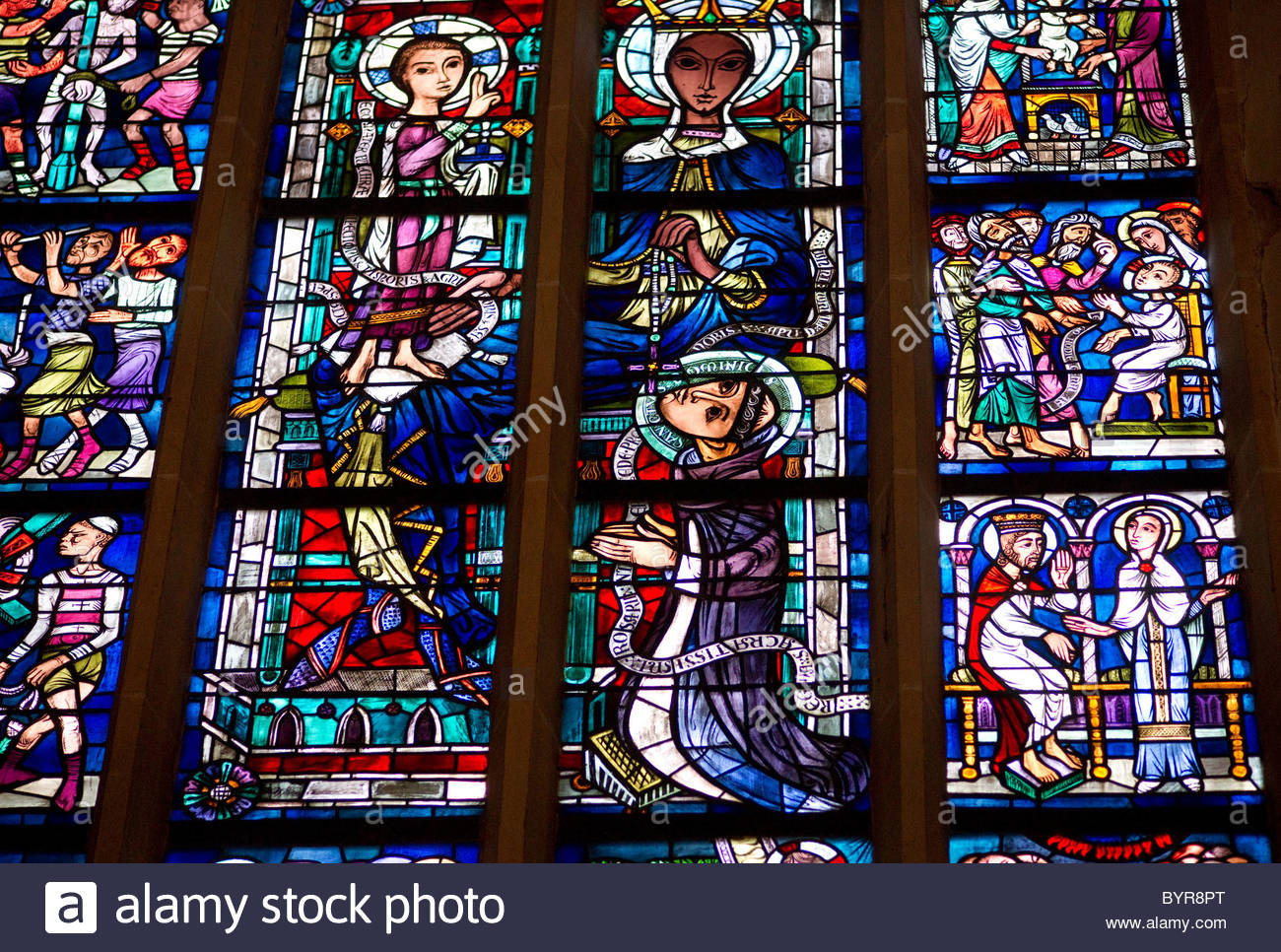 Stained glass windows inside a church – Munich Germany - Stock Image