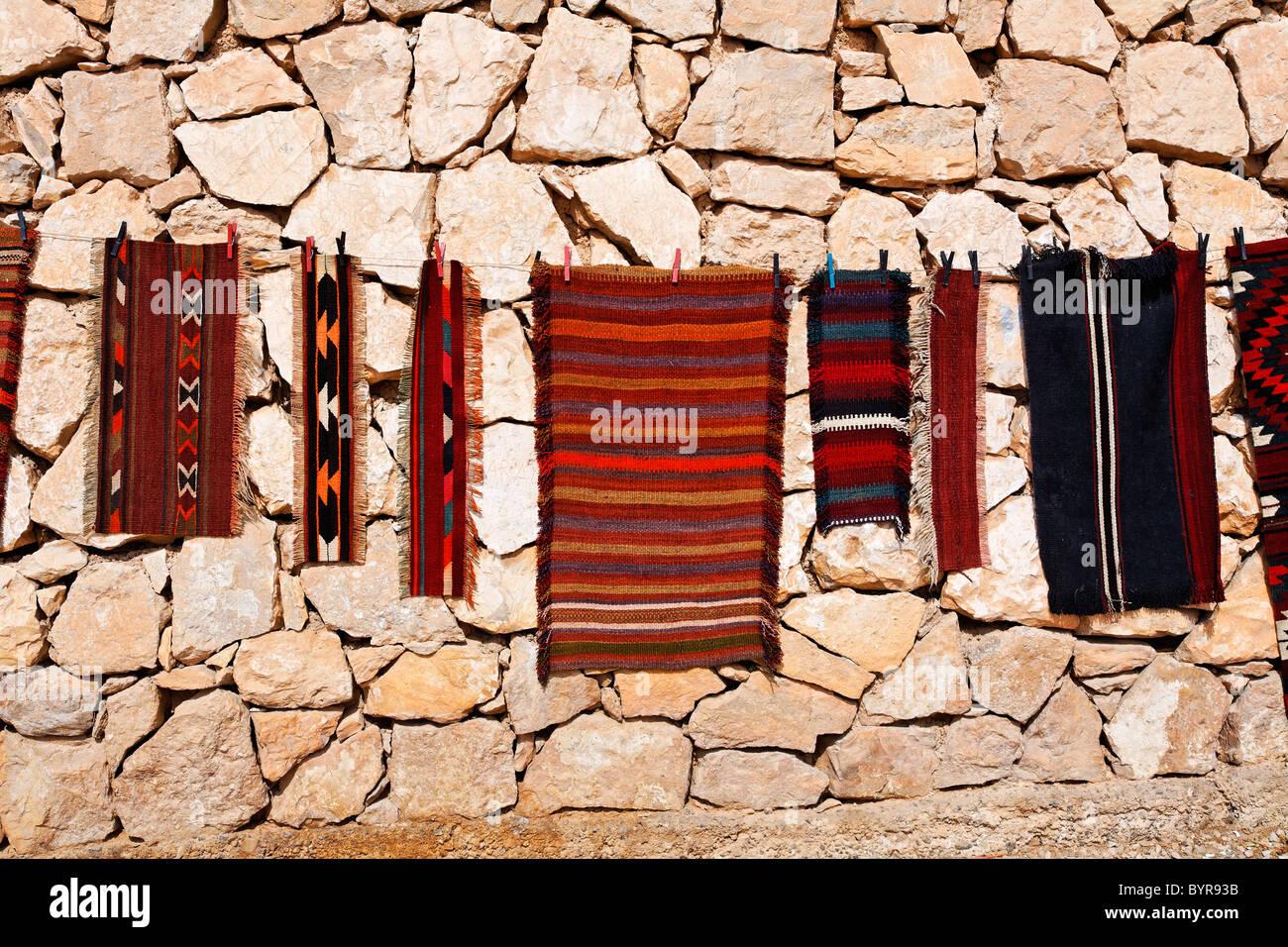 Souvenir rugs for sale at Wadi Mujib, Jordan - Stock Image