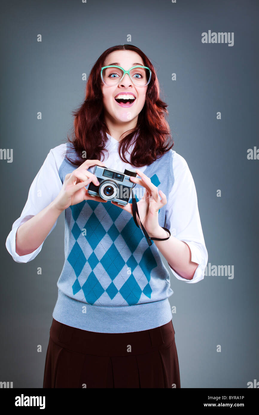 Geeky woman with camera - Stock Image