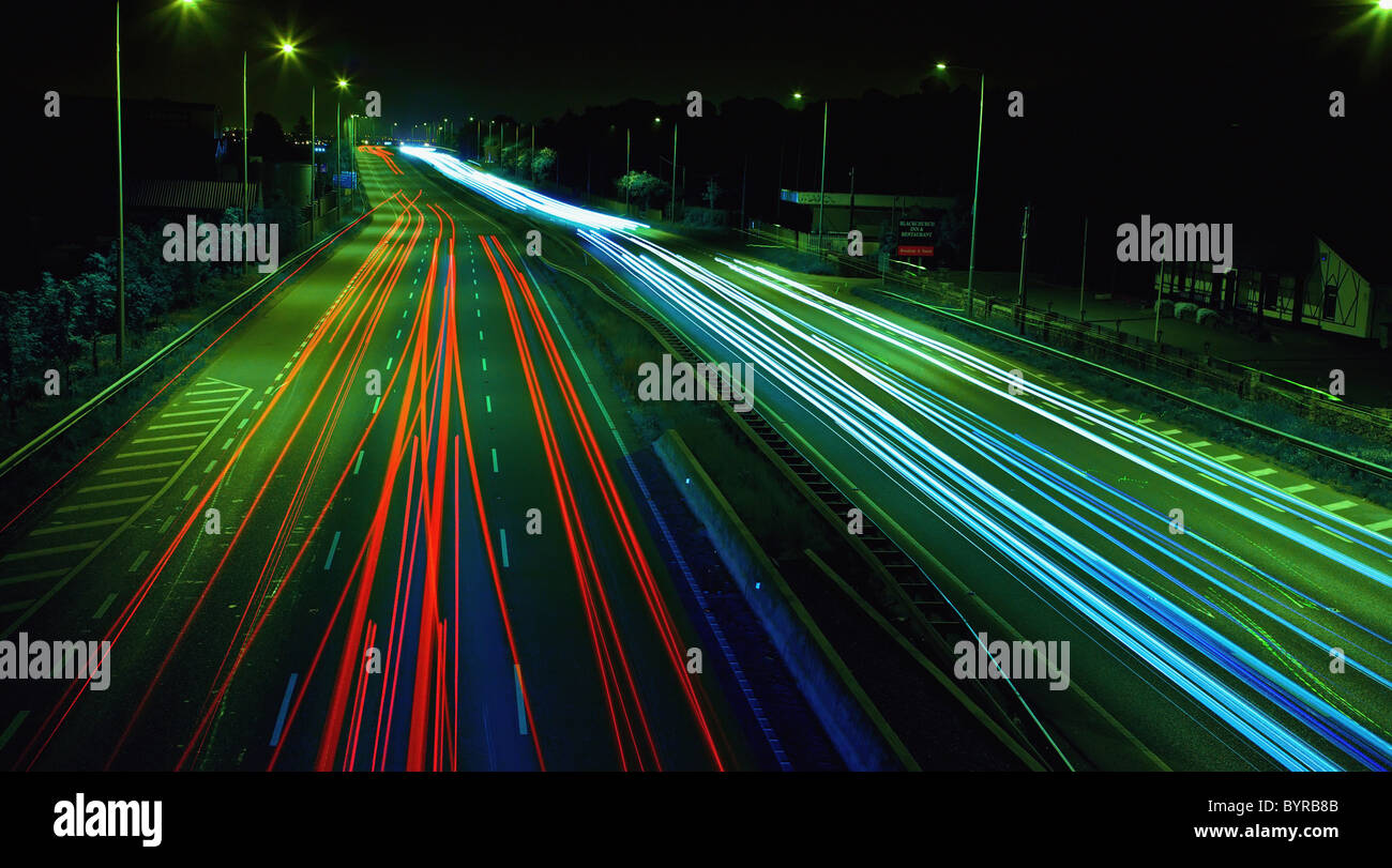 light trails down a busy road at night; dublin, ireland - Stock Image