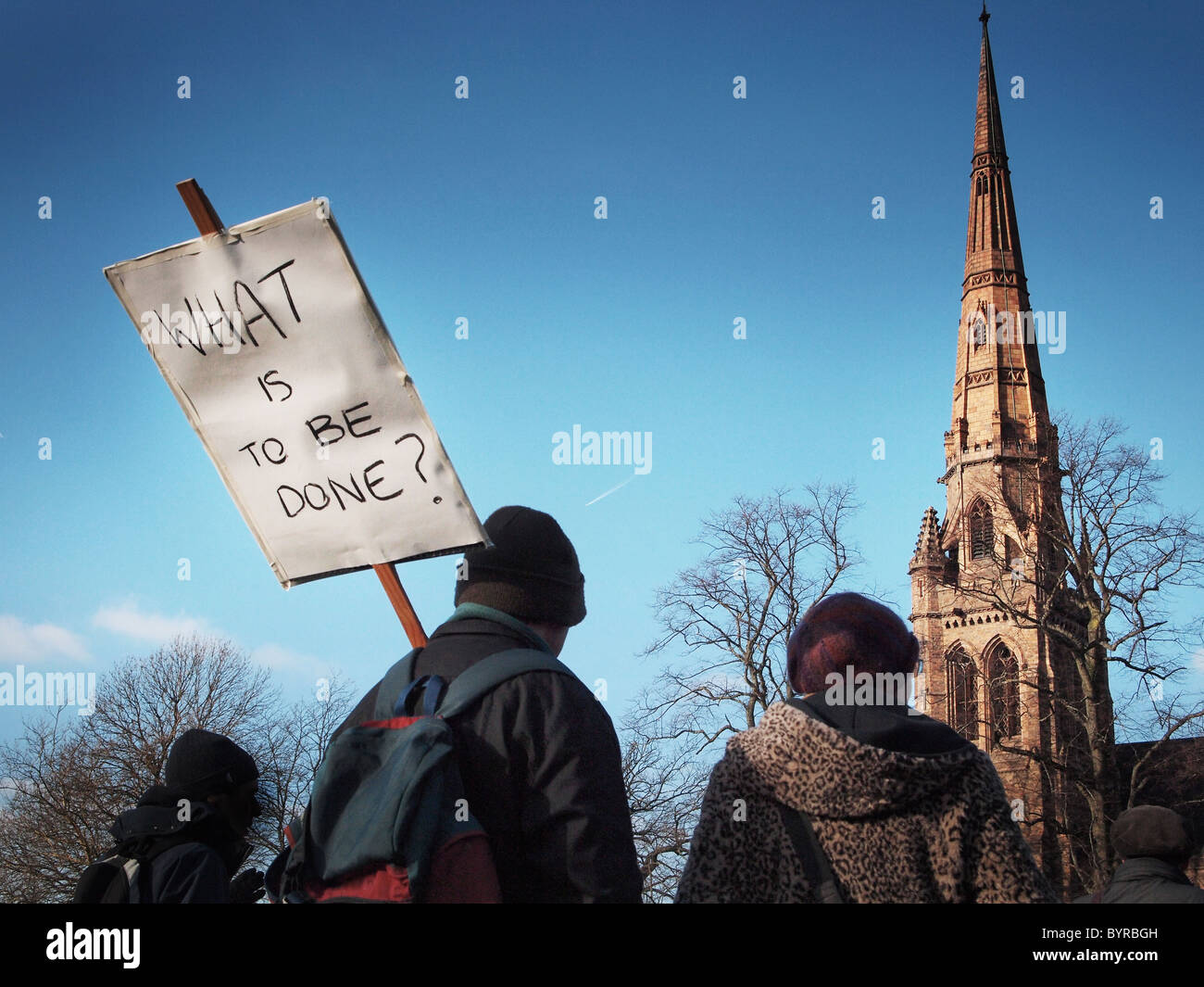 OLYMPUS DIGITAL CAMERA Students protesting against tuition fee rises with banner through Manchester - Stock Image