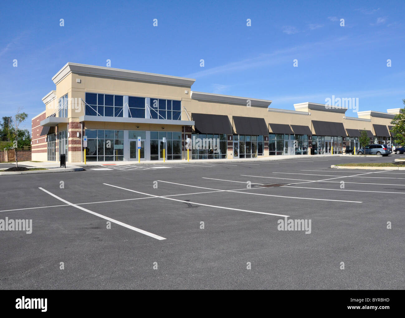 Exterior of several storefronts for a shopping area - Stock Image