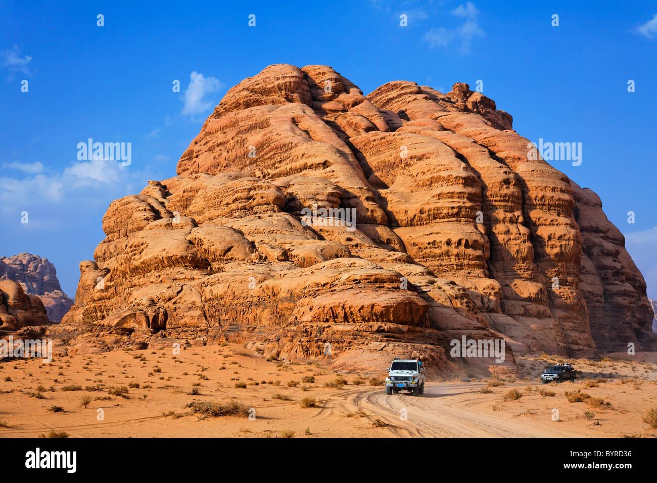 Desert safari in four wheel drive vehicles at Wadi Rum, Jordan - Stock Image