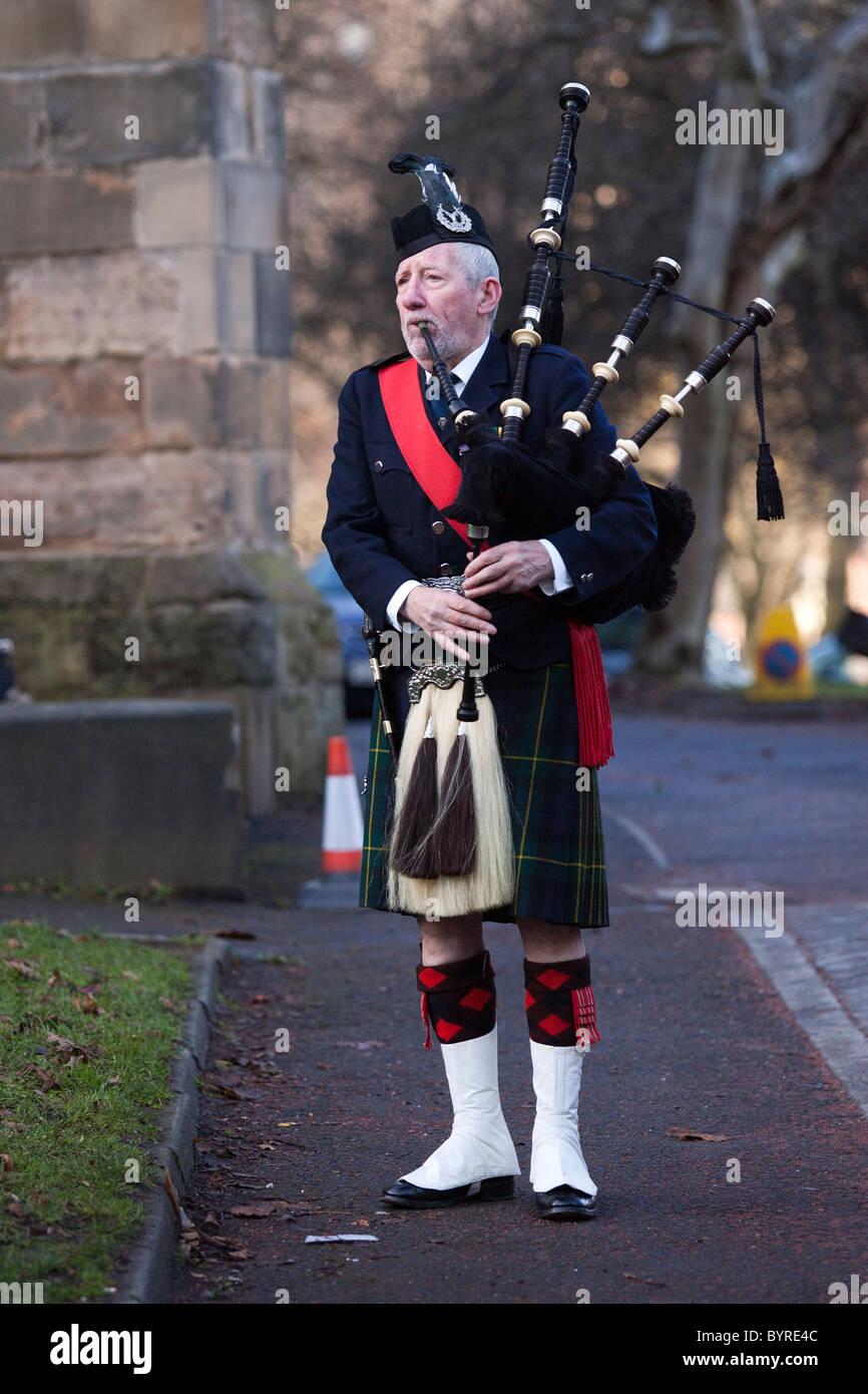 UK - Scotland - January 2011. Scottish Piper in Full Highland Regalia. Stock Photo