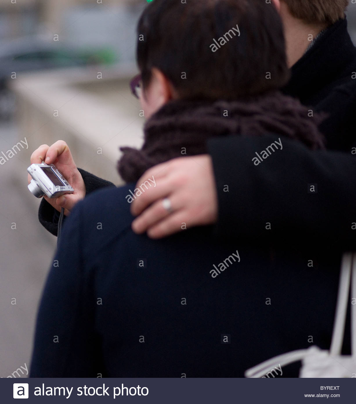 Person taking pictures with s compact digital camera - Paris France Stock Photo