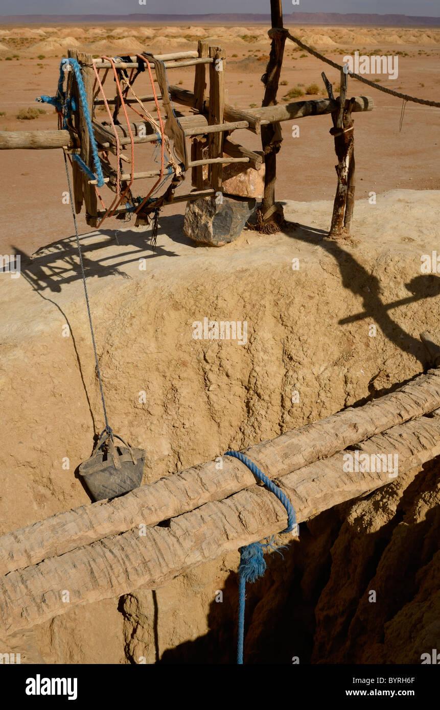 Pulley rope and bucket at Khettara well in the arid Tafilalt basin of Morocco - Stock Image