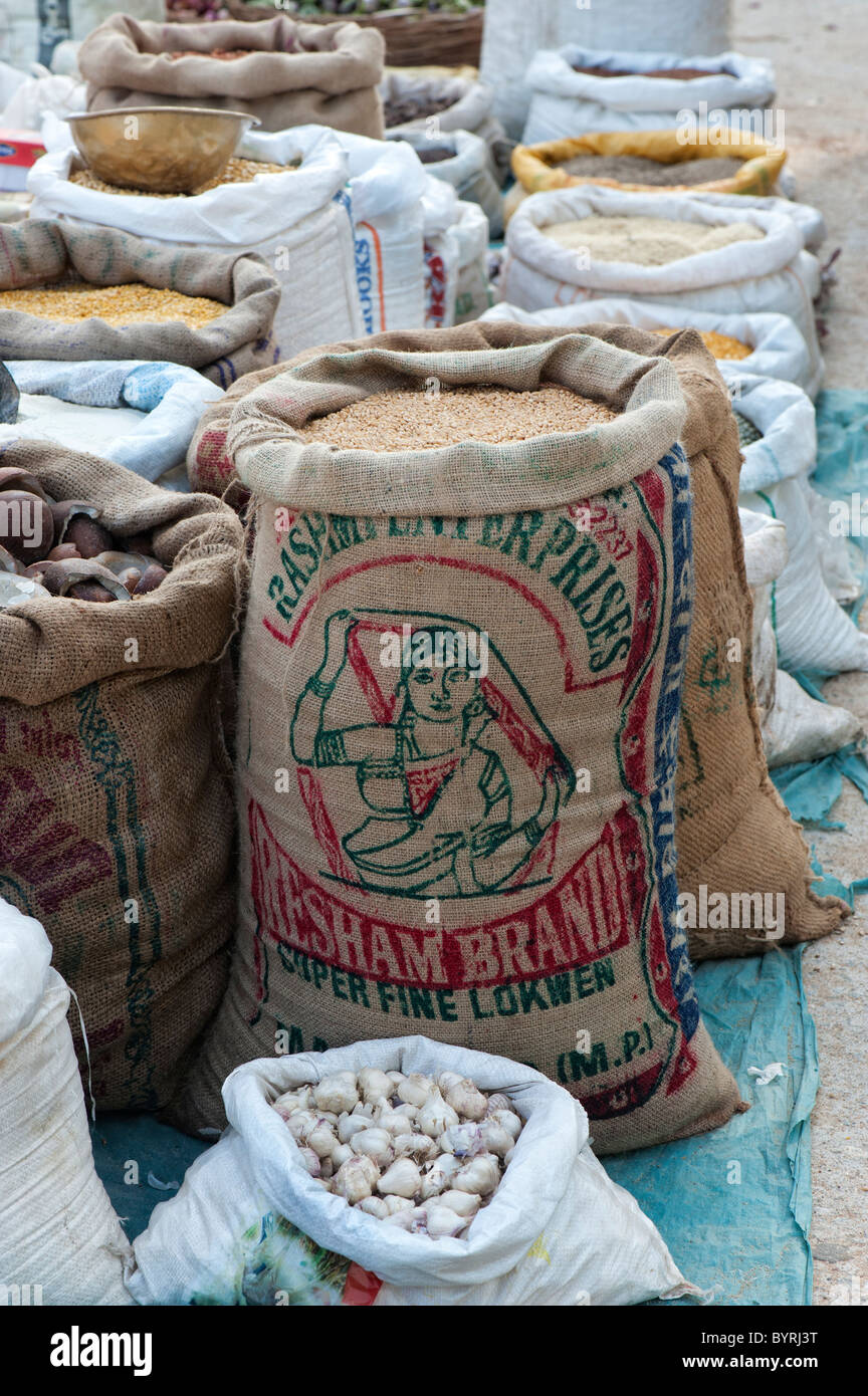 Sacks of wheat grain and dried produce at an indian street market. Andhra Pradesh, India - Stock Image