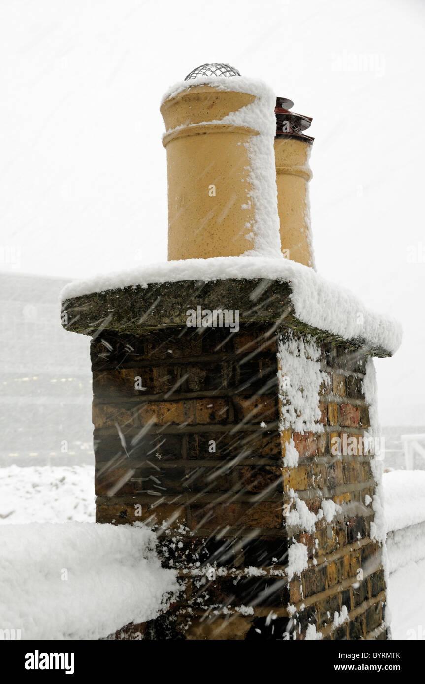 Chimney pots under snow - Stock Image