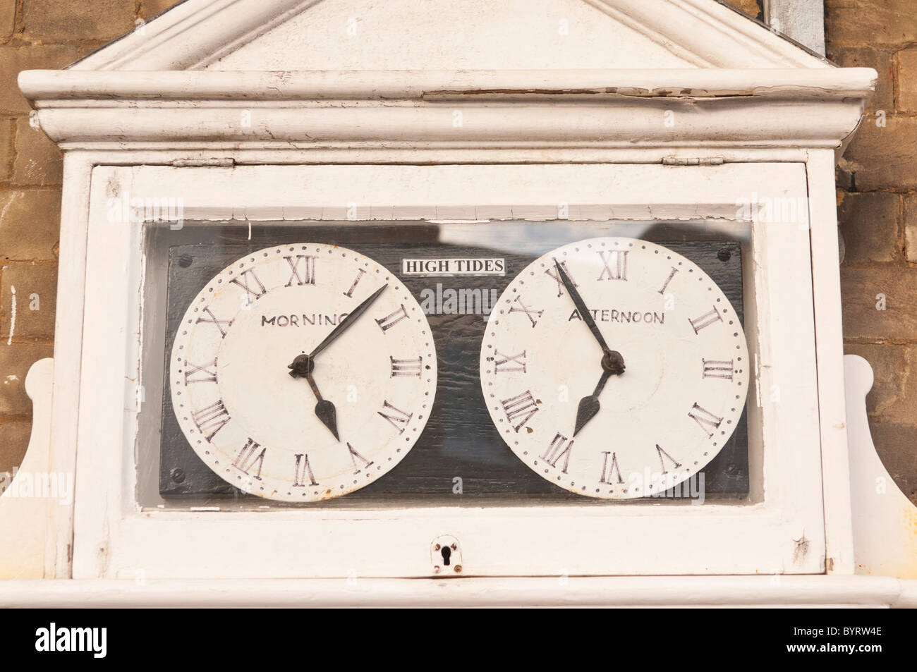 Clocks showing high tide timetables in Southwold , Suffolk , England , Britain , Uk - Stock Image