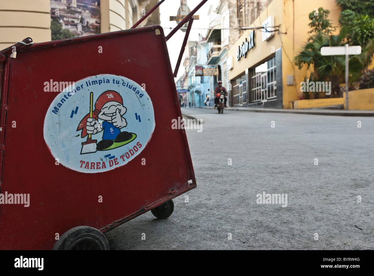Street dustbin with political signs. Santiago de Cuba, Cuba, Caribbean. - Stock Image