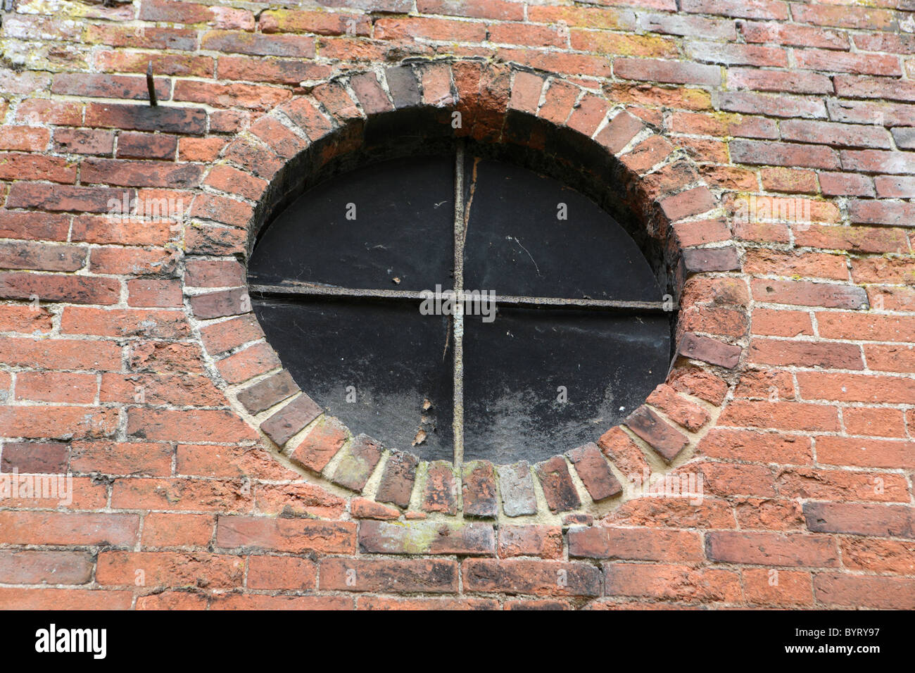 round window boarded up - Stock Image