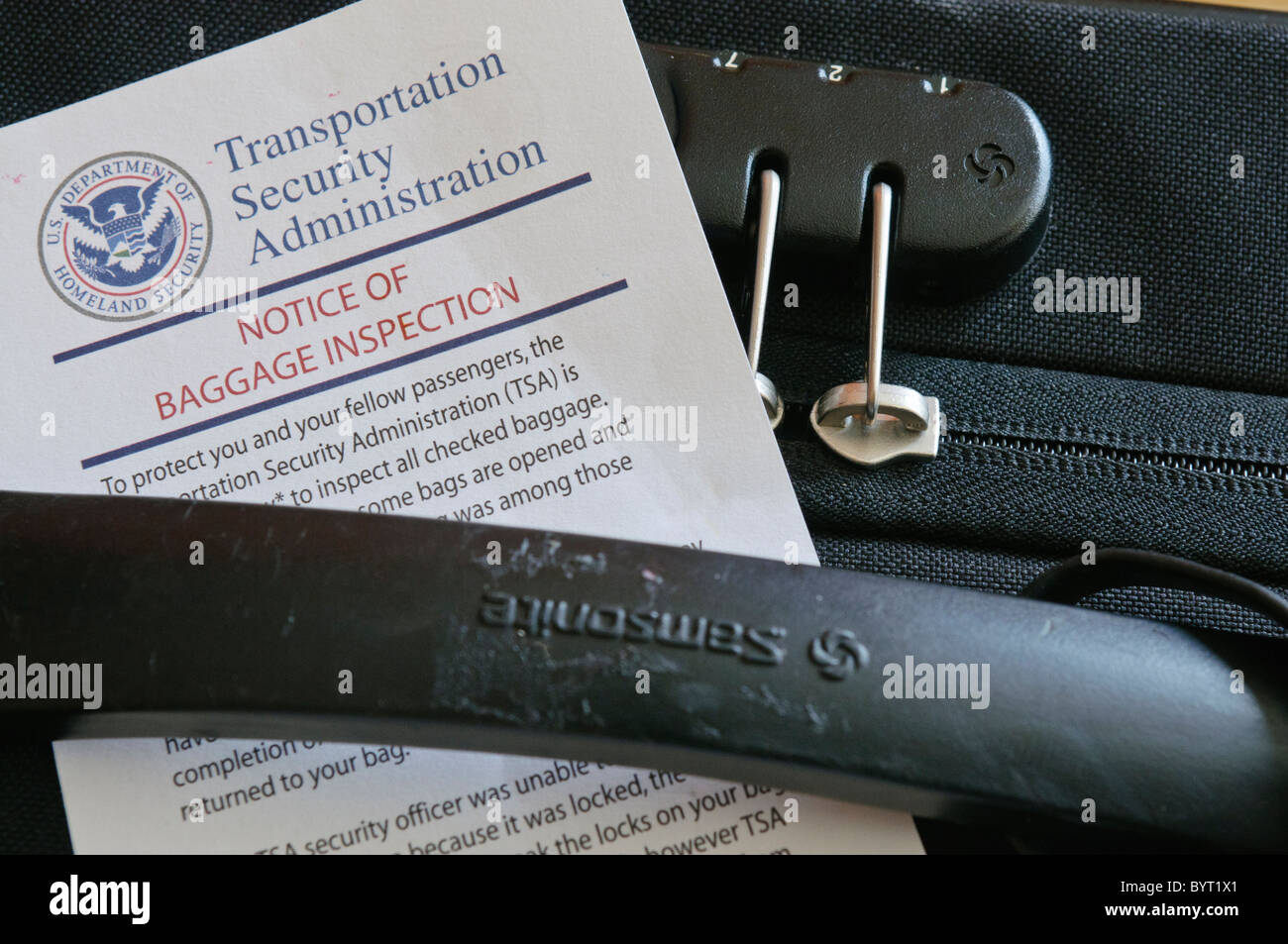 TSA Notice of Baggage Inspection on a suitcase - Stock Image