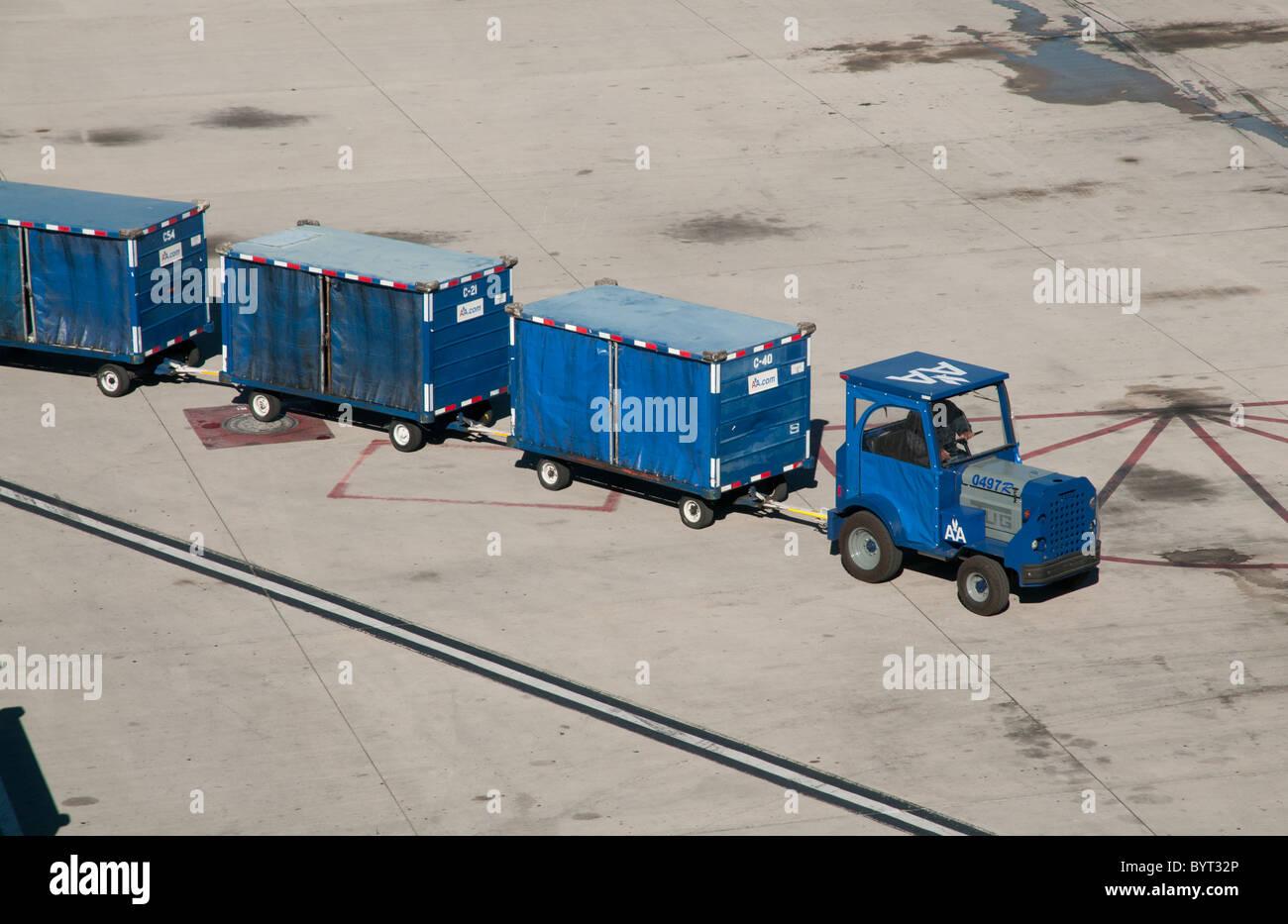 Luggage truck train airside at McCarran International Airport - Stock Image
