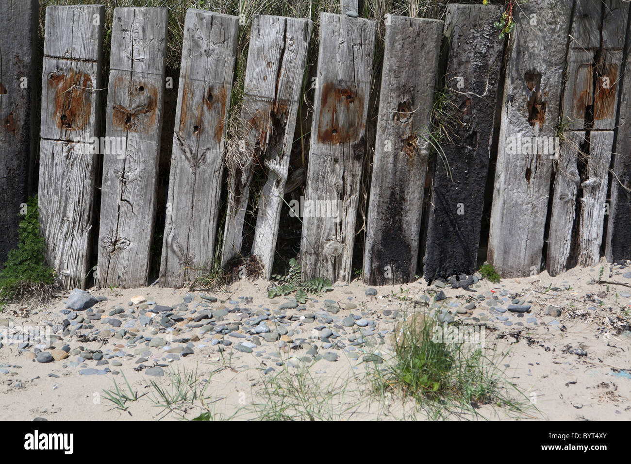 Old railway sleepers used as a fence - Stock Image