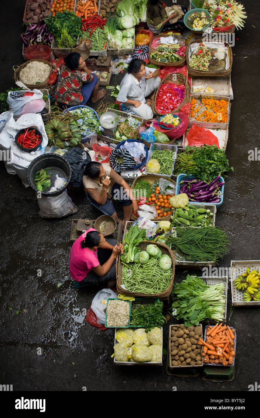 The public market in Ubud, Bali, is a colorful and busy place in the early morning when Balinese people come to - Stock Image