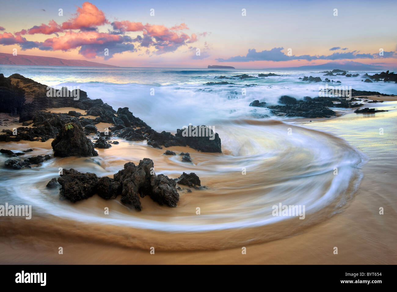 Wave pattern and sunrise clouds. Maui, Hawaii - Stock Image