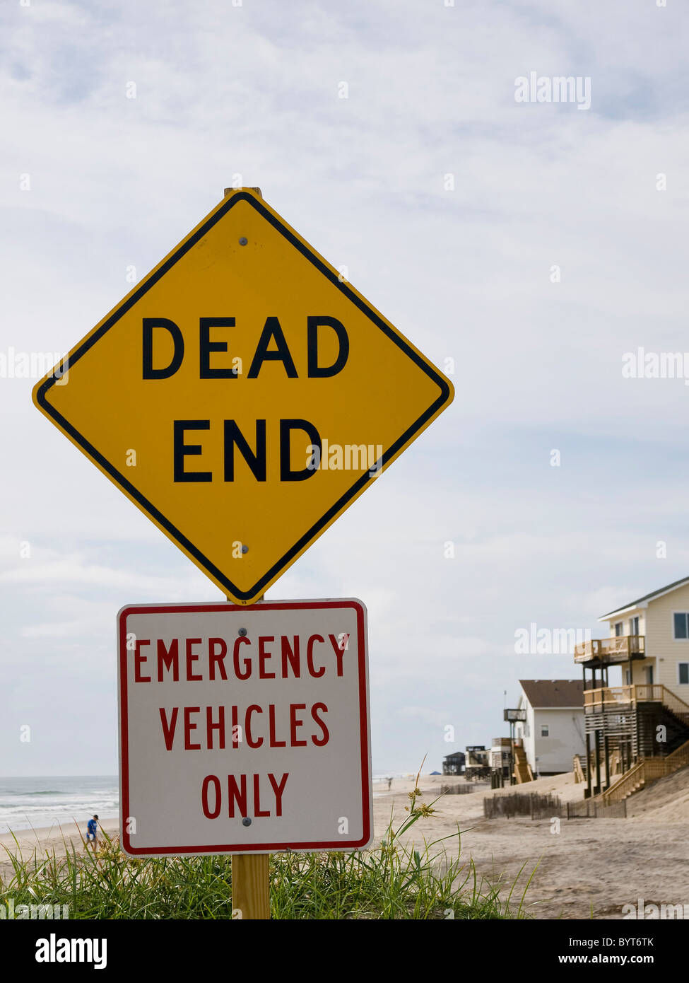 End of the road sign Nags Head North Carolina Outer Banks beach lies beyond the sign only emergency vehicles are - Stock Image