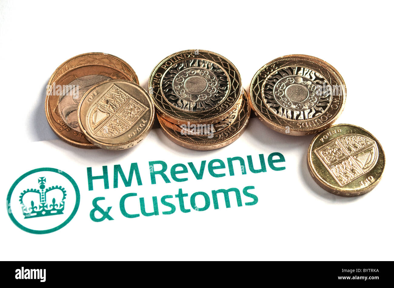 A HM Revenue and Customs Tax form and coins - Stock Image