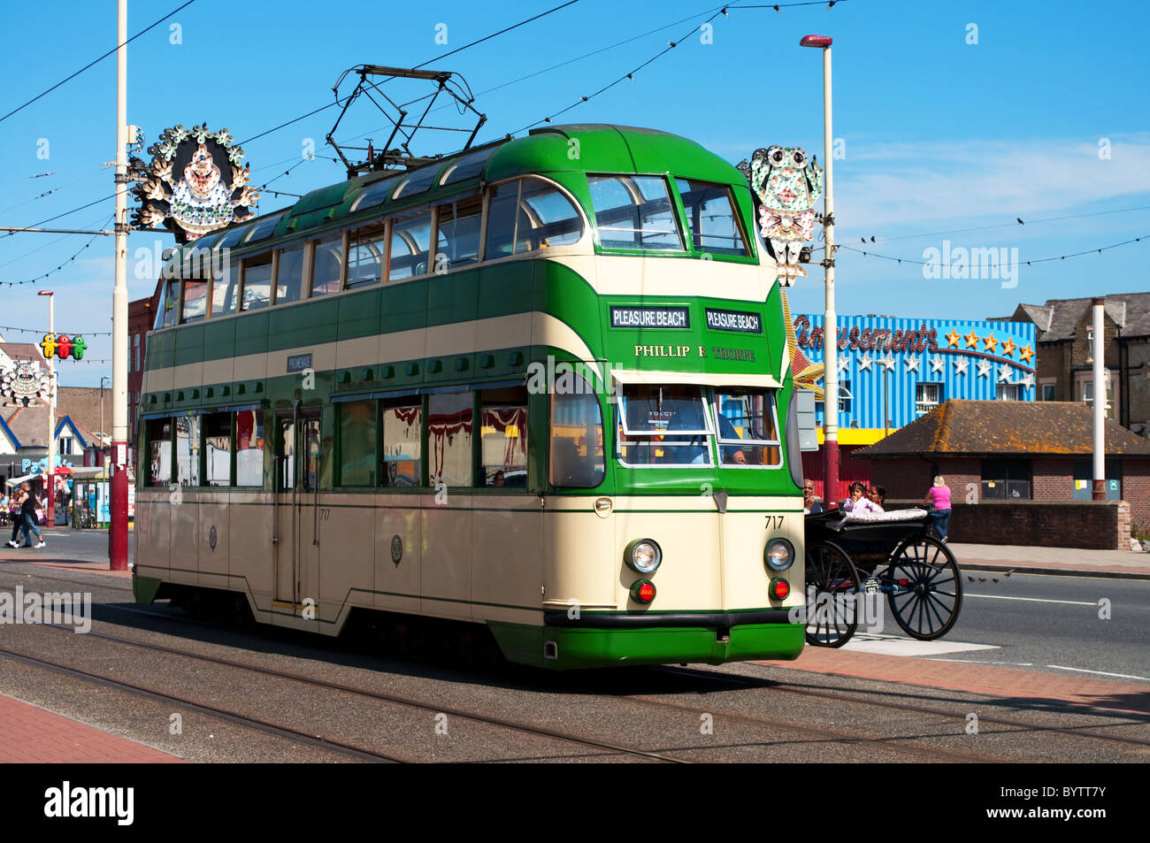 A traditional style tram running along the ' golden mile ' in Blackpool, England, UK - Stock Image