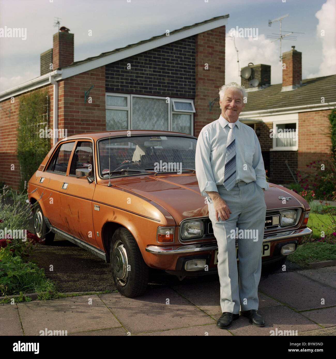 1970s Austin Allegro and owner, Worthing, West Sussex, UK - Stock Image