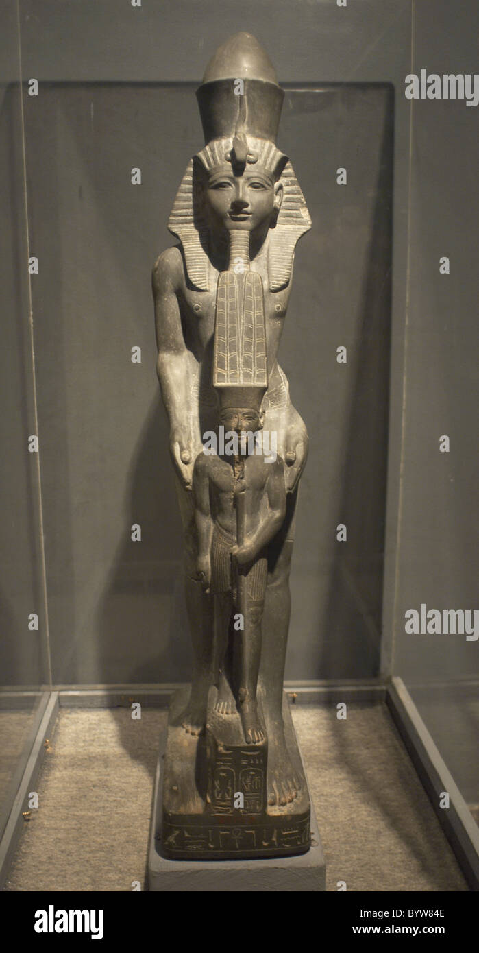 Egyptian art. Pharaoh Ramses IV next to god Amun. 20th Dynasty. New Kingdom. Luxor Museum. Egypt. - Stock Image