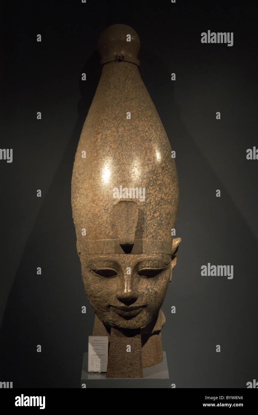 Egyptian Art. Colossal head of pharaoh Amenhotep III (Amenophis or Akhenathon). 18th Dynasty. New Kingdom. - Stock Image
