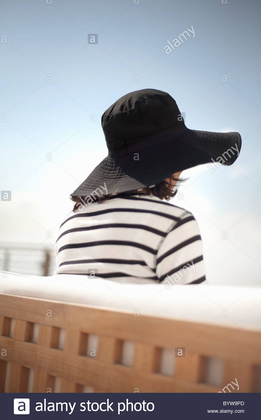 Rear view of woman in sun hat - Stock Image