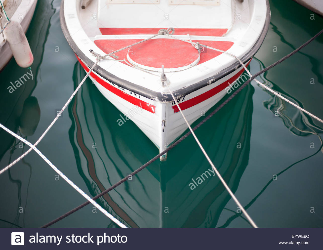 Small boat moored in harbour - Stock Image