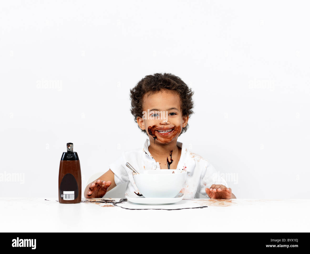 Boy covered in chocolate sauce - Stock Image