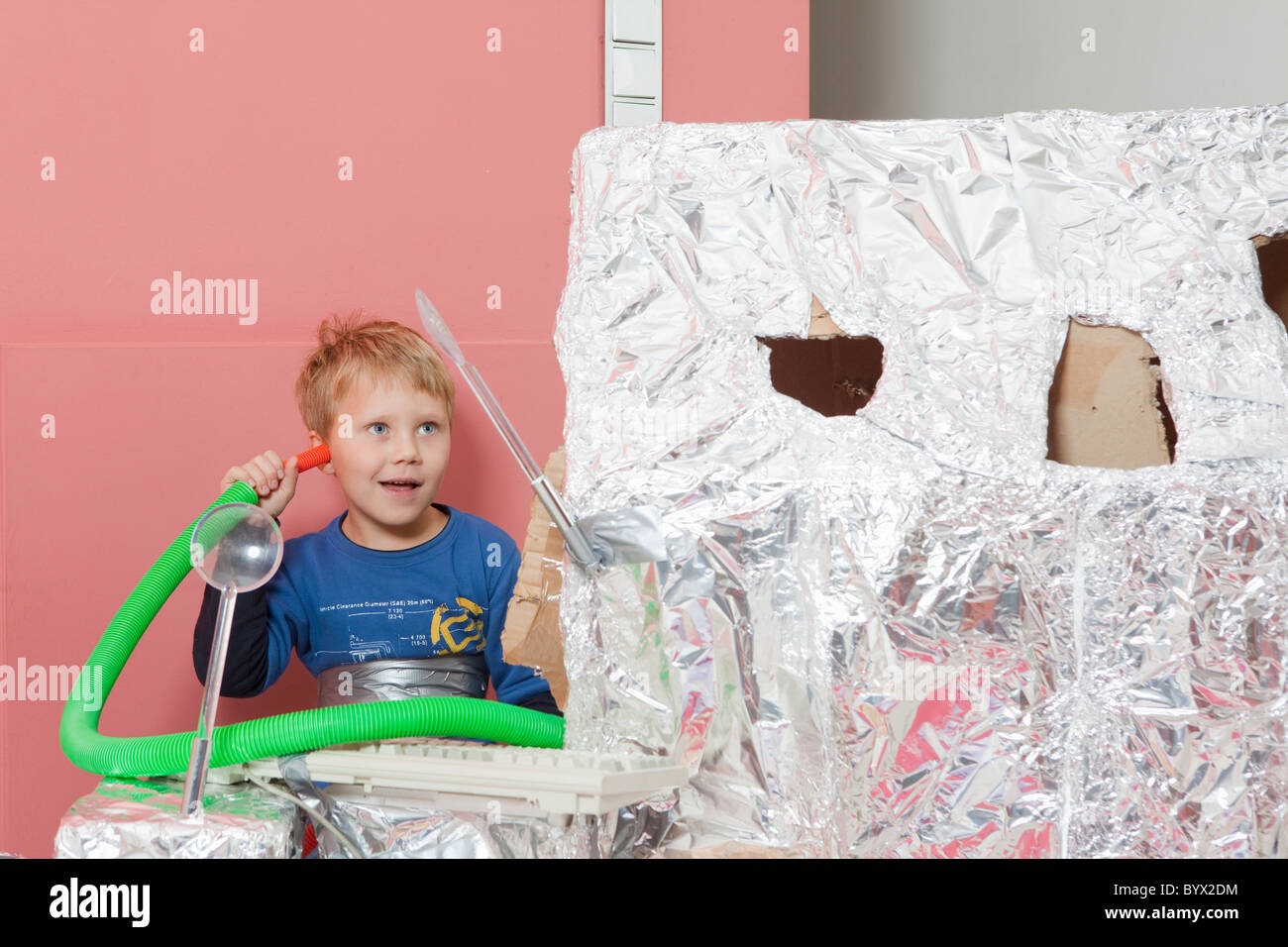 Boy with space house, communicating - Stock Image
