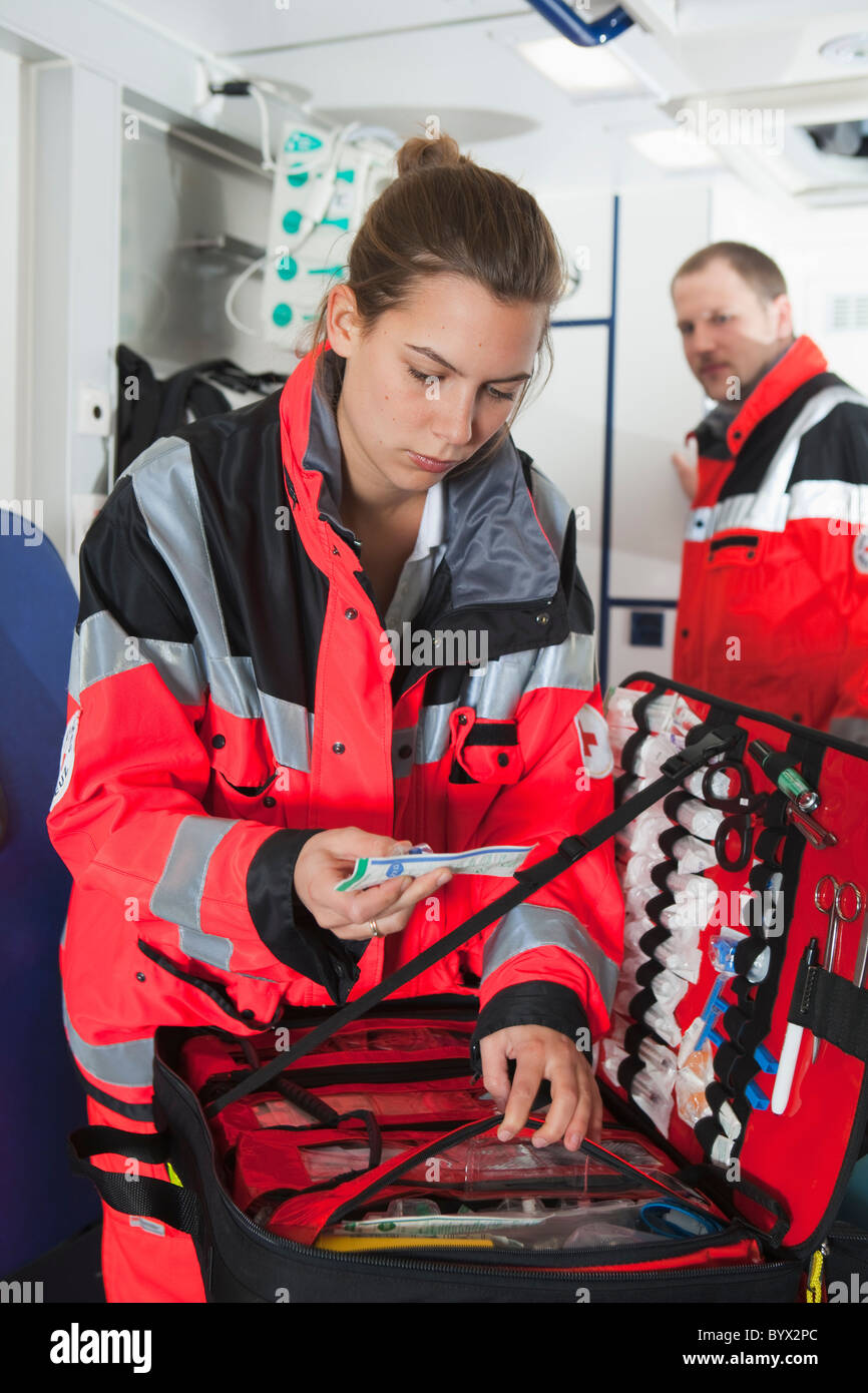 Ambulance woman in coach, preparing - Stock Image