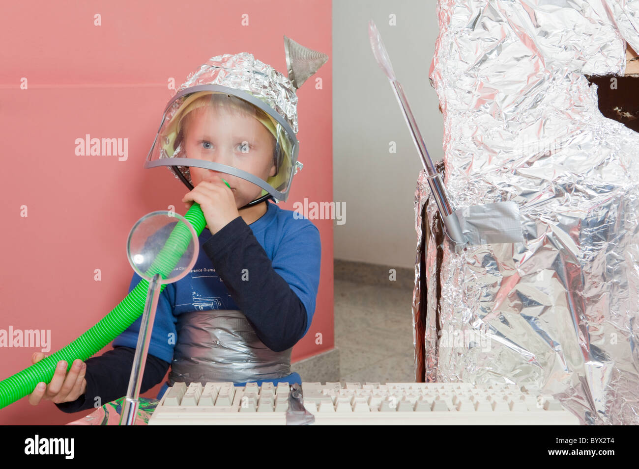 Boy with self constructed space house - Stock Image