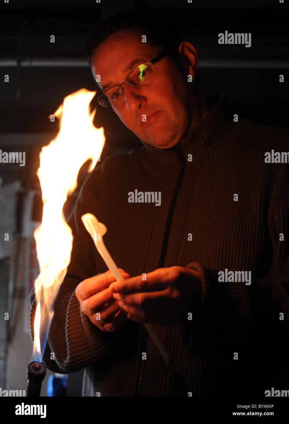 Darren West a neon glass blower, he is one of the few left working in the country - Stock Image