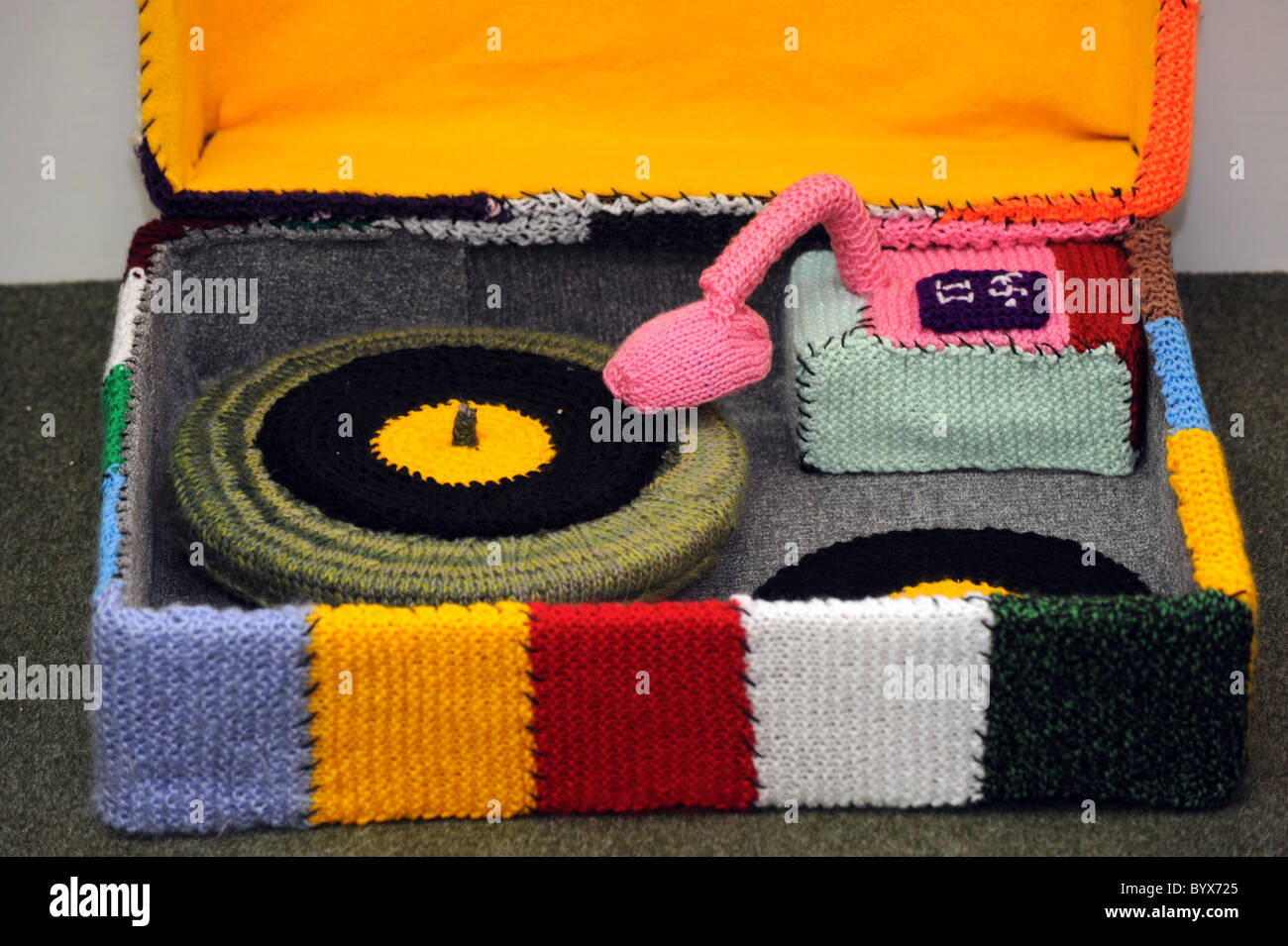 Volunteers from homeless charity Emmaus in Brighton have knitted a life size living room complete with knitted objects - Stock Image