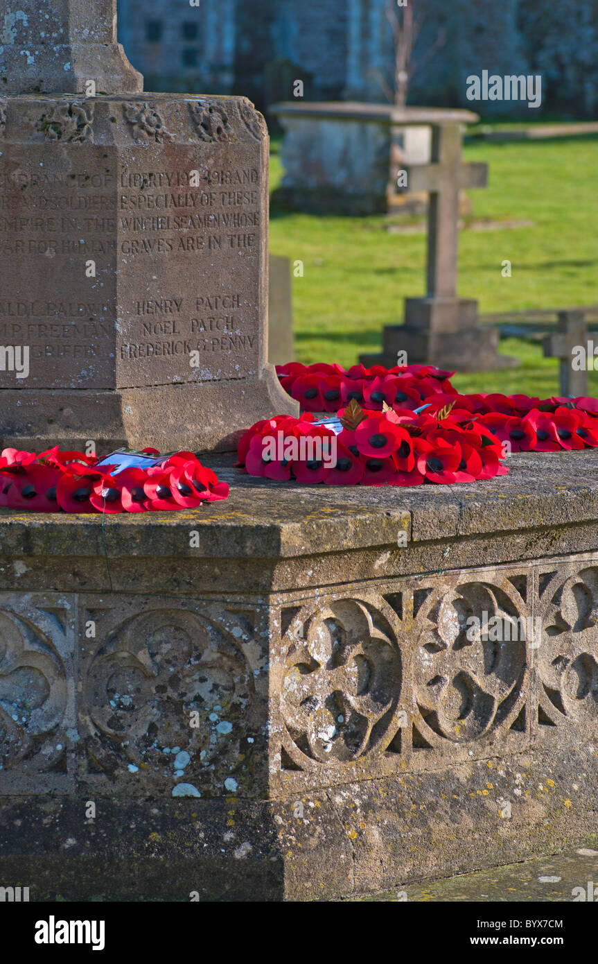 Poppy Wreaths On A War Memorial - Stock Image