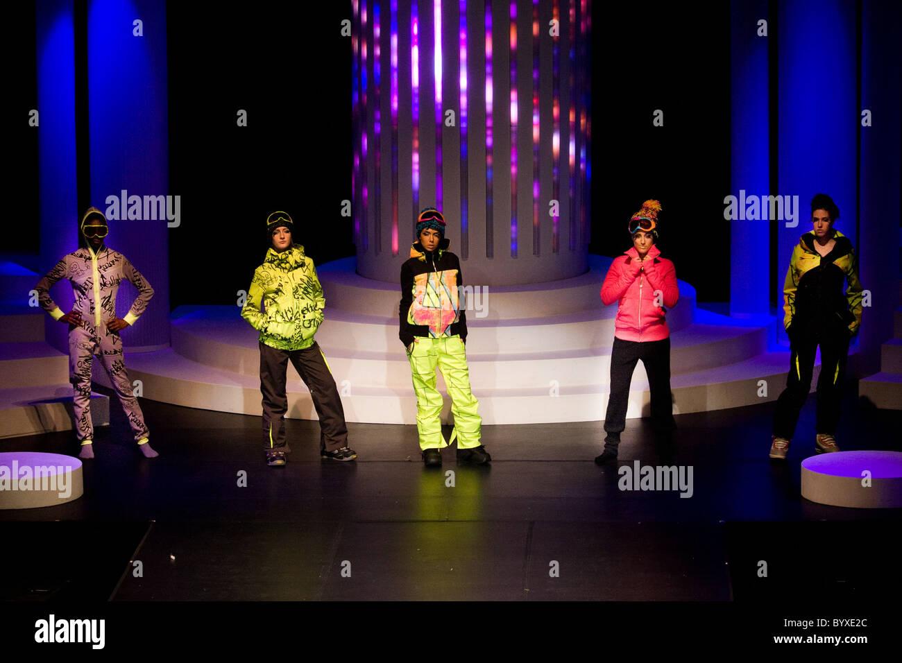 five female models standing runway school show - Stock Image