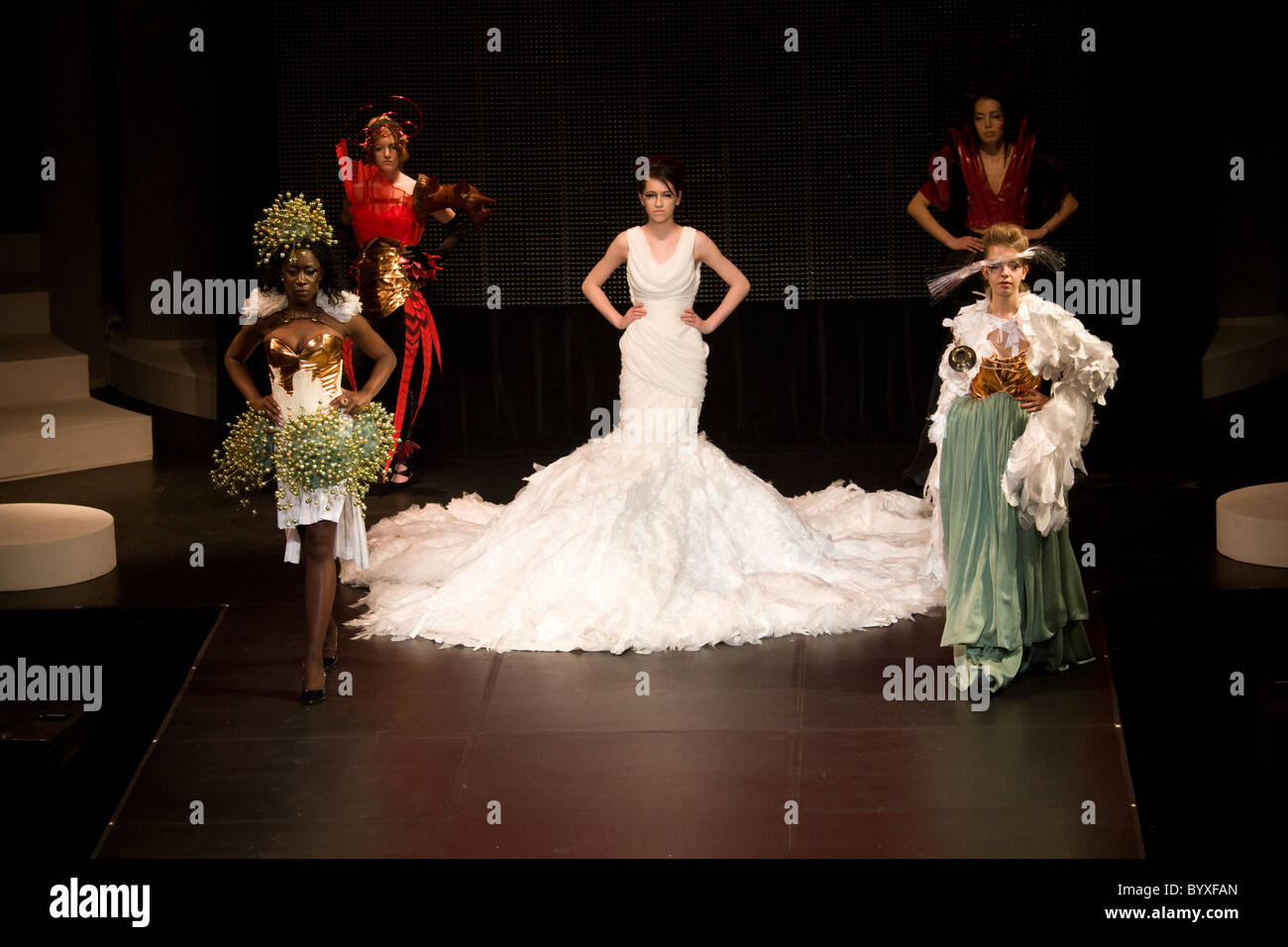 school fashion show group female models walking - Stock Image