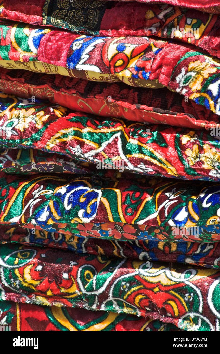 Velvet cushions for sale on a stall outside Chorsu Bazaar, Tashkent, Uzbekistan - Stock Image