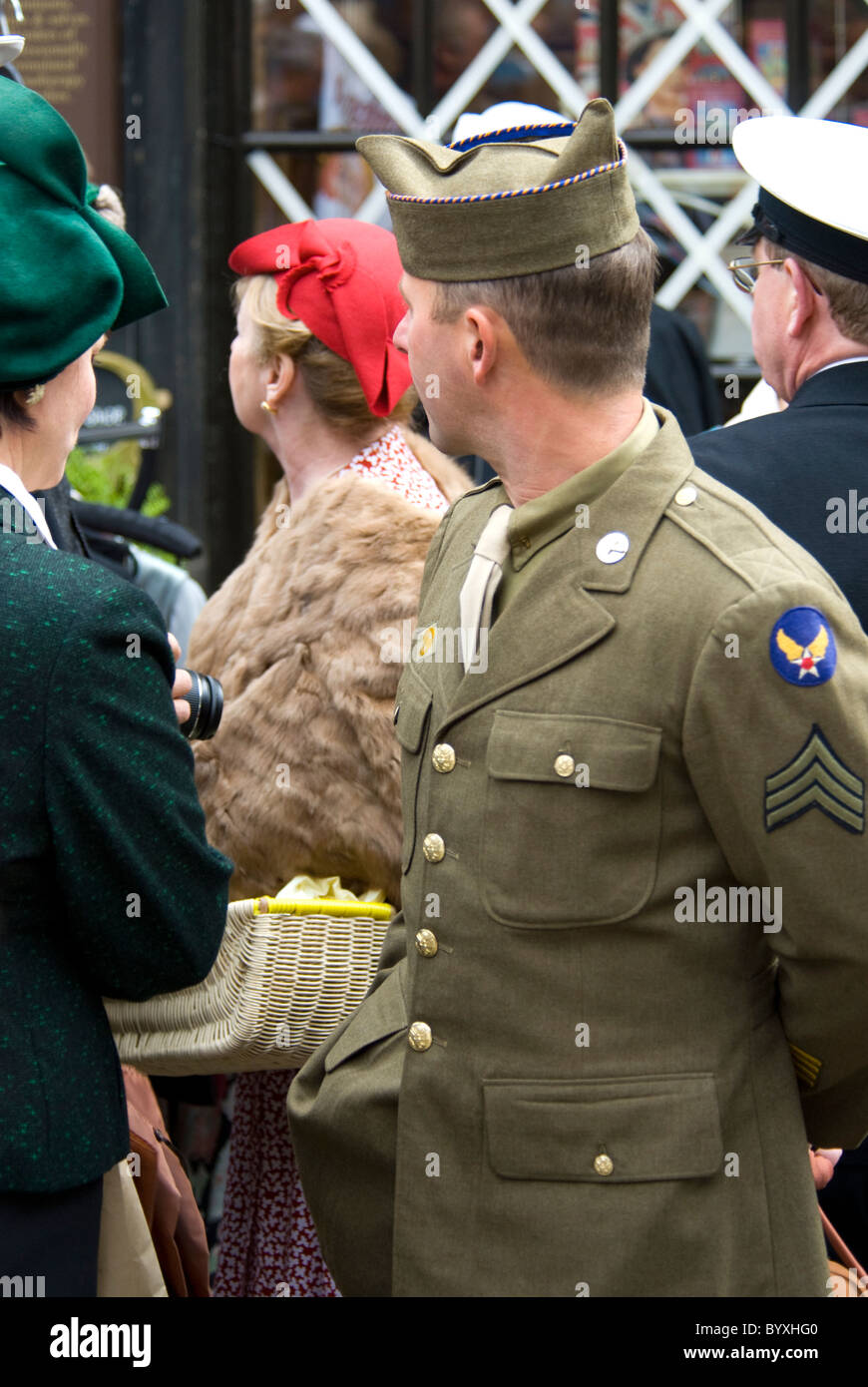Military uniforms and civilian costumes at the Haworth 1940s weekend. - Stock Image