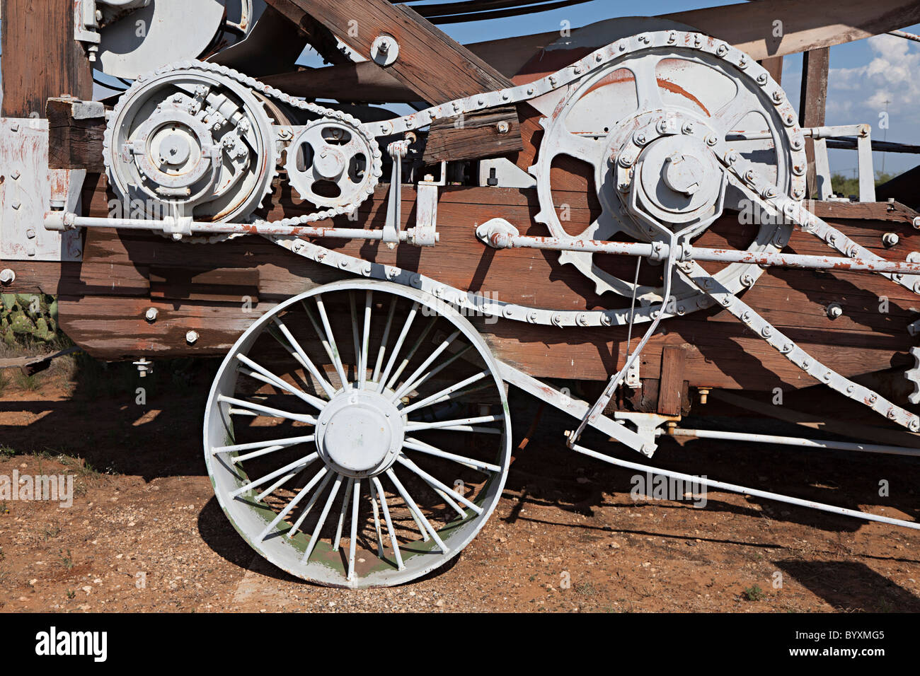 Detail of wheels gears and chains on Star Spudder 45C drilling machine Permian Basin Petroleum Museum Midland Texas - Stock Image