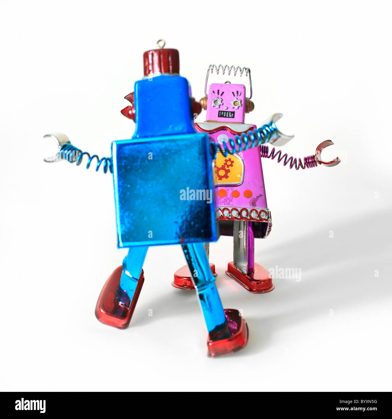 Dancing toy robots, male and female likeness. - Stock Image