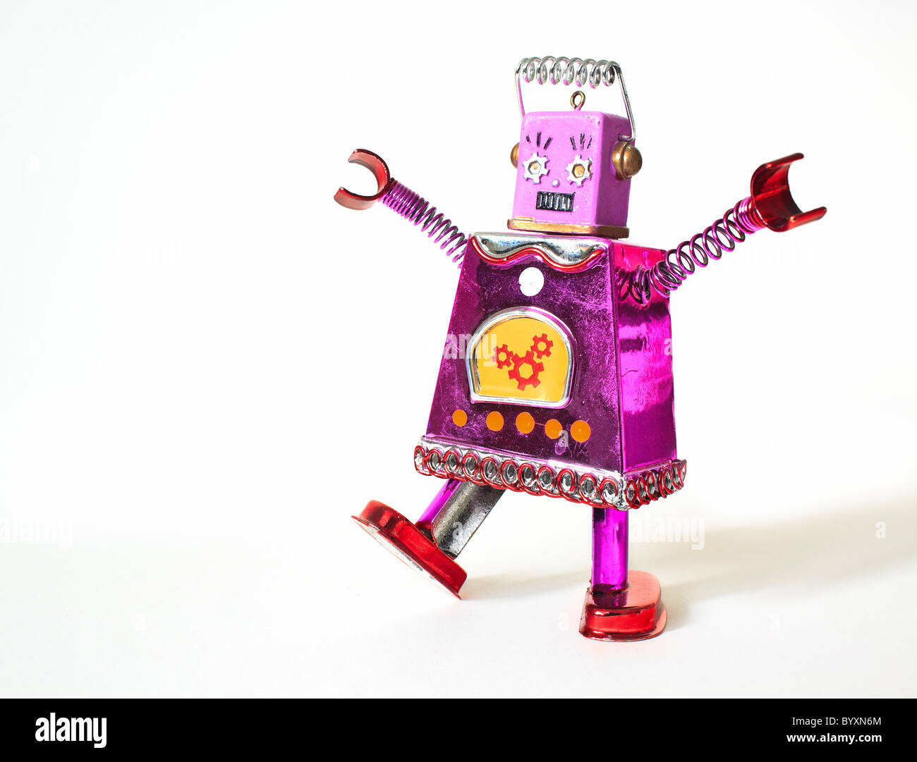 Tin toy robot dancing, with arms raised, (conceptual image), female likeness. - Stock Image