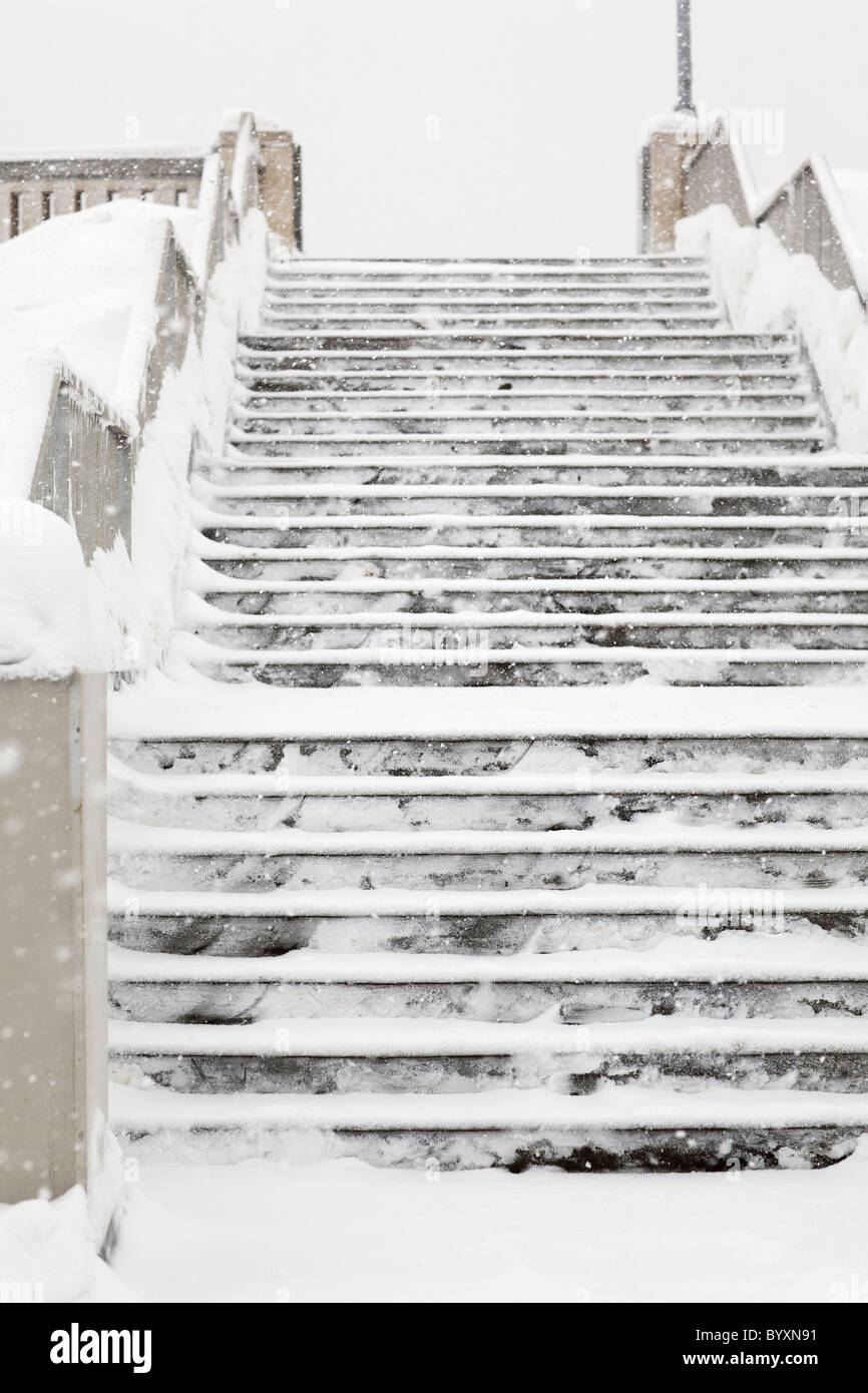 Concrete stairs covered in snow, Winnipeg, Manitoba, Canada. - Stock Image