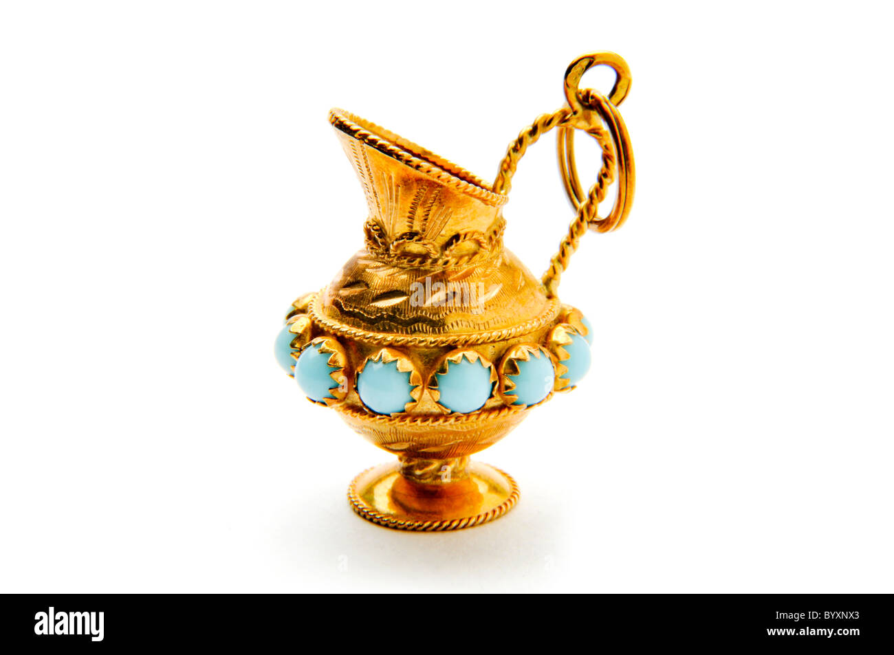 small gold necklace pendant of drinking pitcher circa 1962 - Stock Image