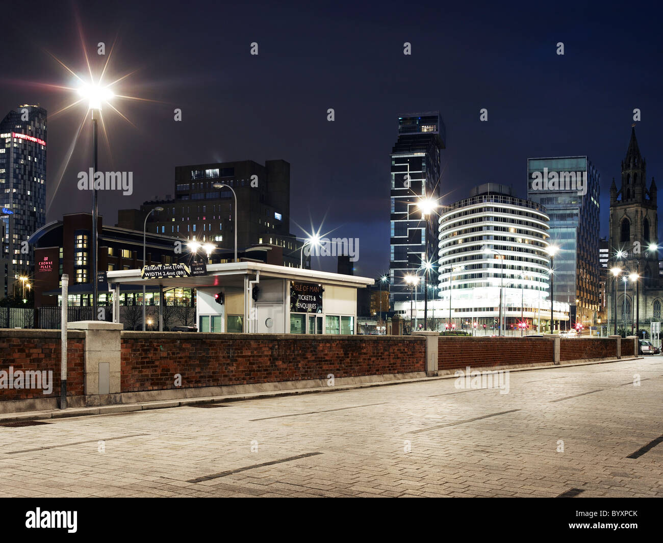 Image of liverpool skyline at night using long exposure, showing tall buildings and urban landscape from pier head - Stock Image