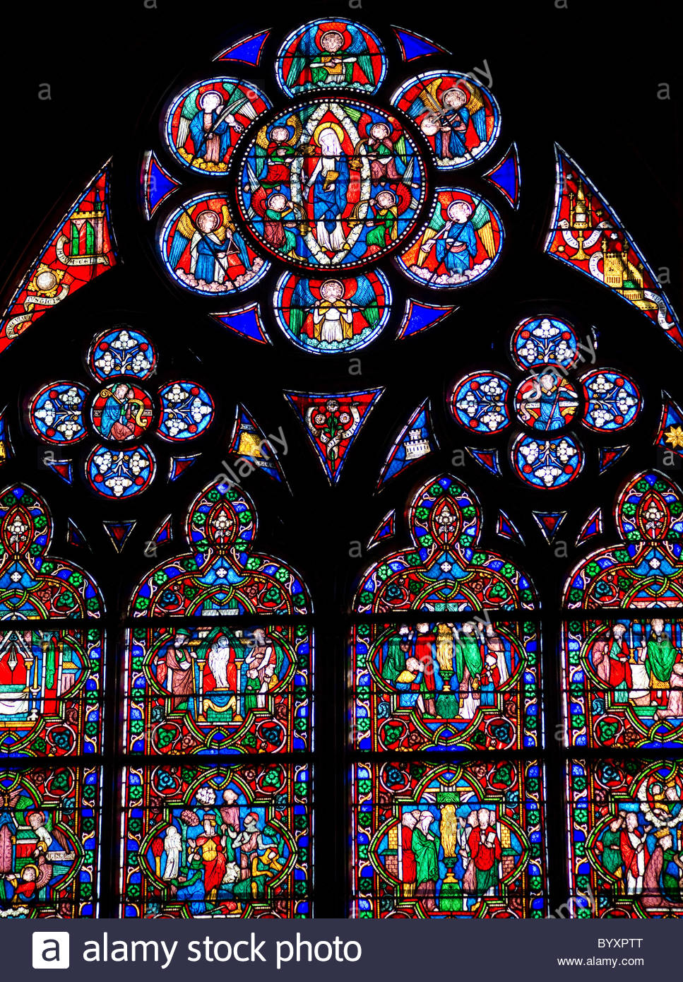 Stained glass windows inside a church - Paris France Stock Photo
