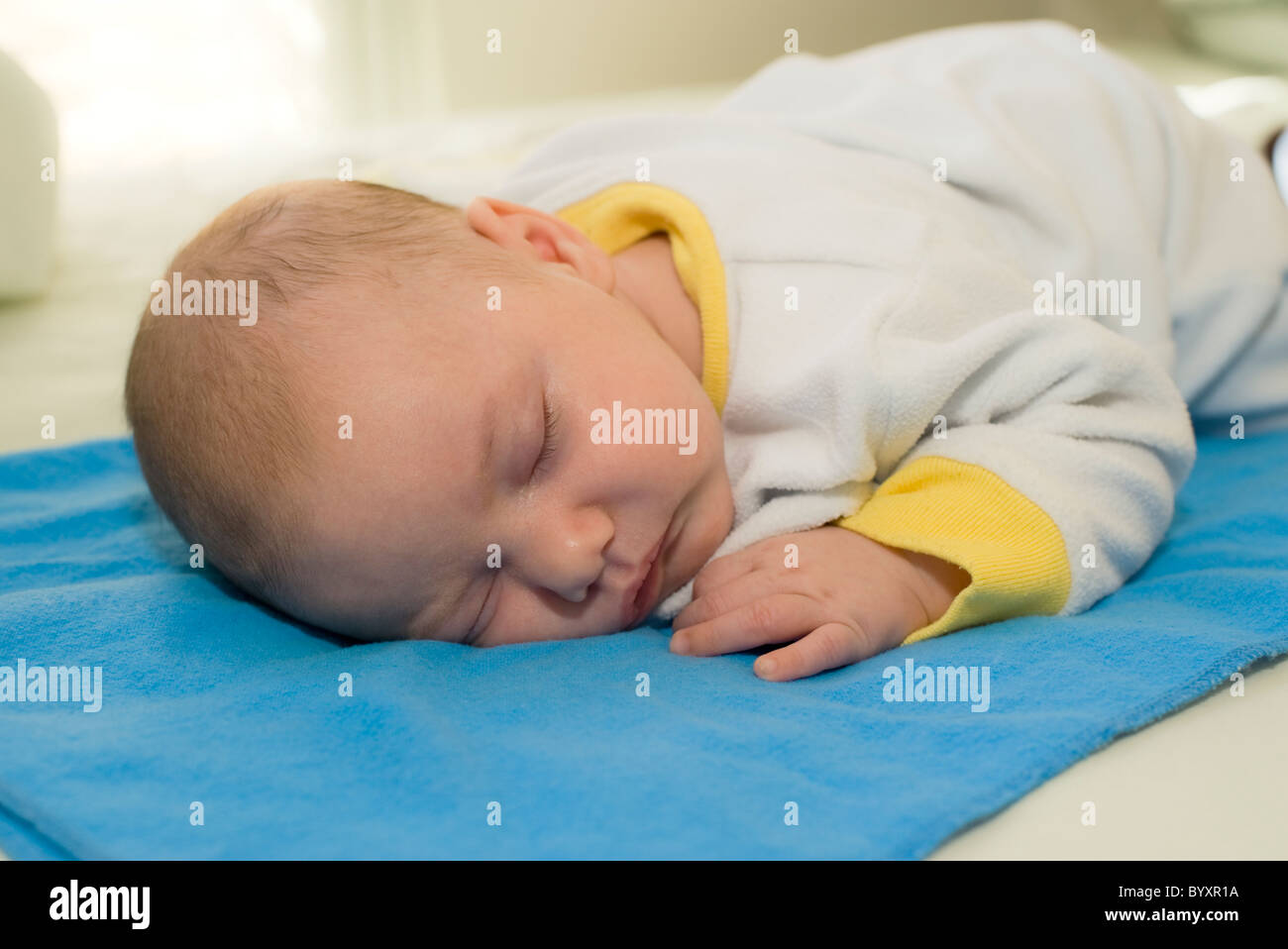 Sleeping 2 month old baby boy. Parent model released - Stock Image