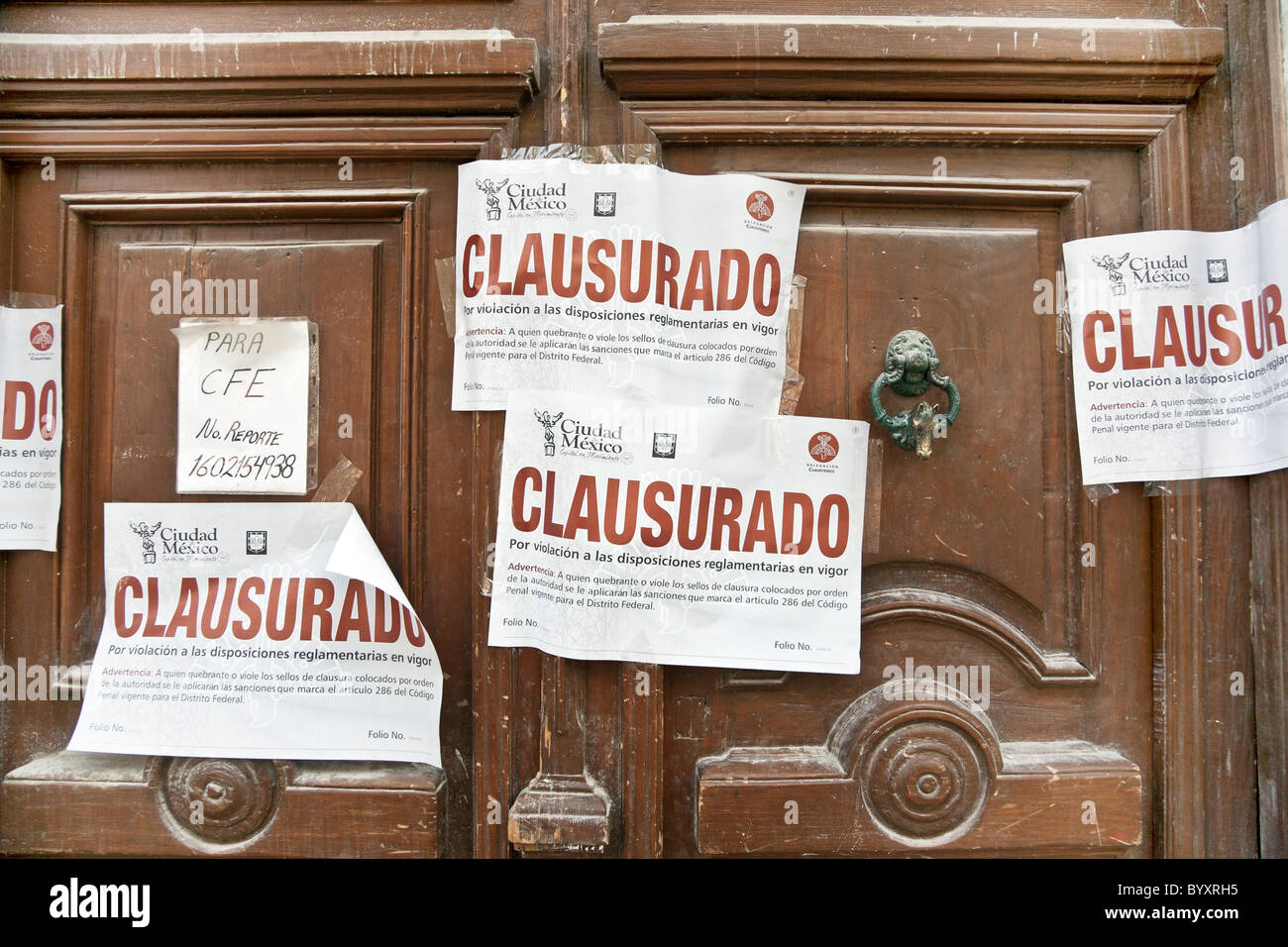 public notice of construction closure for building department violation  posted on doors to building being renovated - Stock Image